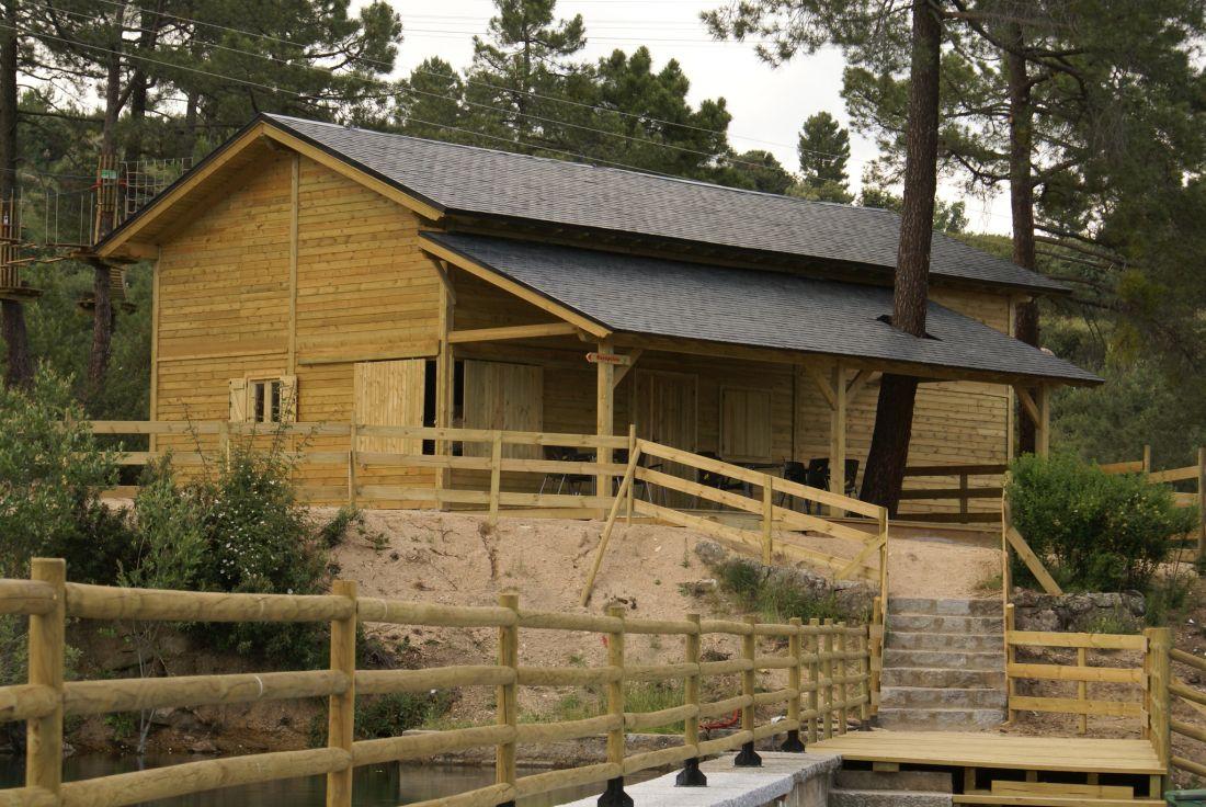 cabaña con estructura timberframe